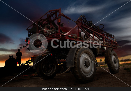 High Clearance Sprayer stock photo, A high clearance spraying against a sunset by Tyler Olson