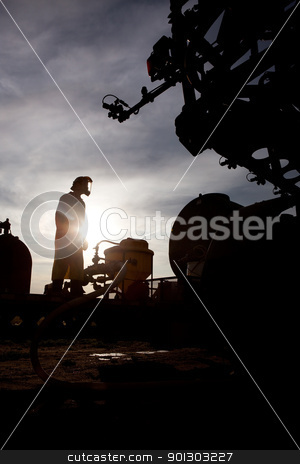 High Clearance Sprayer stock photo, A silhouette of a high clearance sprayer being filled by Tyler Olson