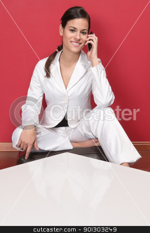Pretty young executive using cell phone stock photo, Beautiful business woman holding cell phone and smiling by Tyler Olson