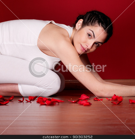 Yoga Woman stock photo, Relaxing woman stretching in spa by Tyler Olson
