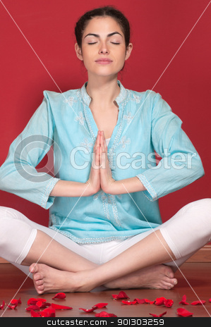 Young woman doing yoga exercise stock photo, Attractive female practicing yoga with rose petals on floor by Tyler Olson