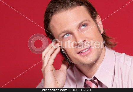 Businessman talking over the cellphone stock photo, Smart businessman talking over the cellphone and looking away by Tyler Olson