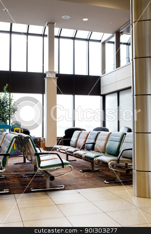 Airport Interior stock photo, An empty interior of an airport with large windows by Tyler Olson