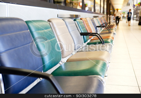 Airport Terminal Chair stock photo, An empty interior of an airport with out of focus people in the background by Tyler Olson