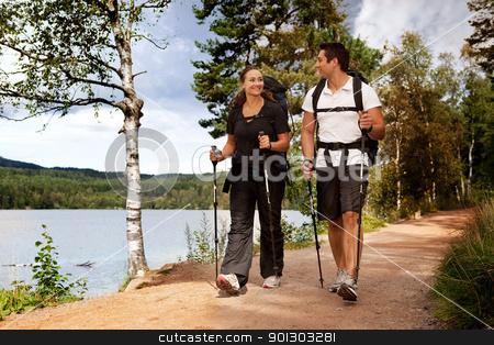 Backpac Couple stock photo, A couple walking on trail with backpacks by Tyler Olson