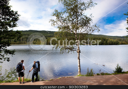 Camping Trip Walk stock photo, Walking and resting on a camping trip by a lake by Tyler Olson
