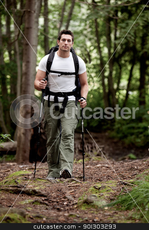 Male Backpacker stock photo, A male backpacking in the forest on a camping trip by Tyler Olson
