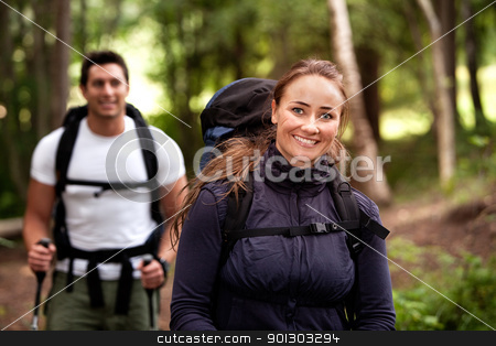 Female Camping Portrait stock photo, A pretty female on a camping trip with a male in the background by Tyler Olson