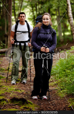Hike Female stock photo, A pretty female on a camping trip with a male in the background by Tyler Olson