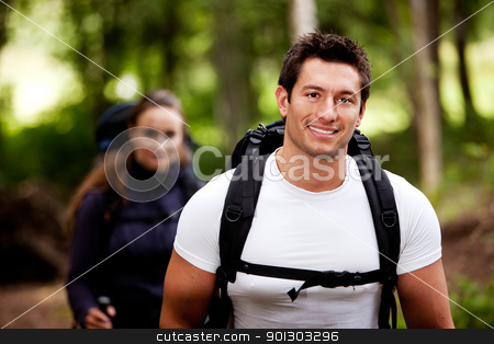 Hike Forest stock photo, A portrait of a male hiking in the forest with a female by Tyler Olson