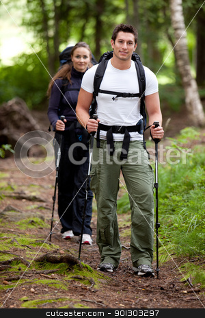 Hike Forest stock photo, A man and woman on a camping trip in the forest. by Tyler Olson