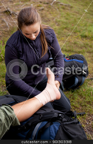 Ankle Tensor Bandage stock photo, A leg tensor bandage being applied outdoors by Tyler Olson