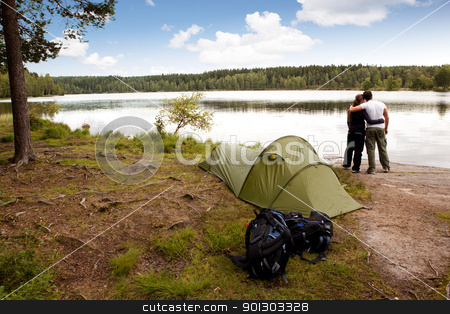 Camping by Lake stock photo, A summer camping lifestyle shot with a forest and lake landscape by Tyler Olson