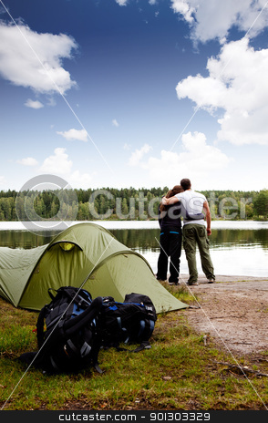 Summer Camping stock photo, A summer camping lifestyle shot with a forest and lake landscape by Tyler Olson