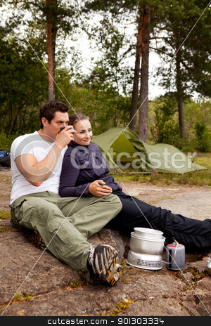 Camping Couple Cooking stock photo, A couple cooking and ejoying the outdoors by Tyler Olson