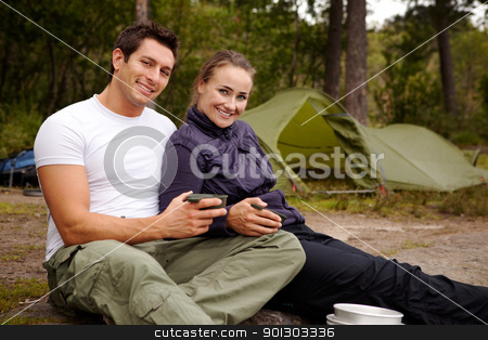 Couple Portrait Outdoor stock photo, An couple enjoying the outdoors while camping. by Tyler Olson