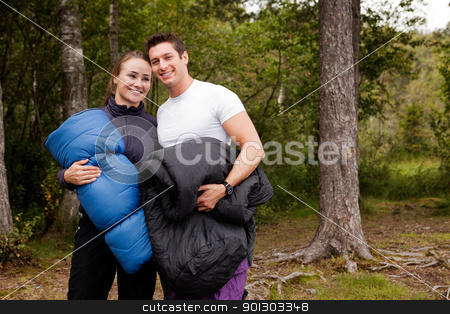 Happy Campers stock photo, A couple of happy campers standing with sleeping bags by Tyler Olson