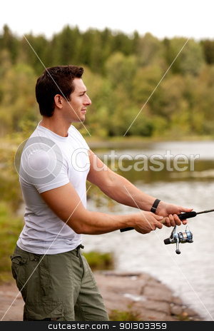Fishing Man stock photo, A man fishing on a inerior lake with forest in the background by Tyler Olson