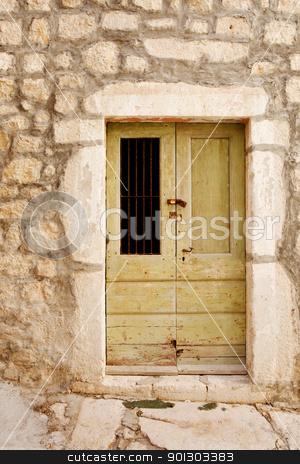 Old Wooden Door stock photo, An old wooden door in a stone building by Tyler Olson