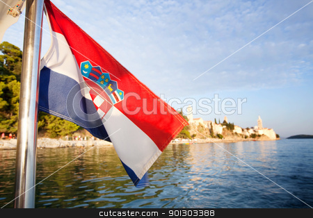 Croatia Flag and Landscape stock photo, A croatian flag in front of a landscape of the island of Rab by Tyler Olson