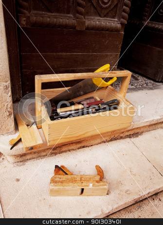 Old Wood Working Tools stock photo, Old wood working tools on stone steps of a building by Tyler Olson