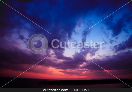 Sunset stock photo, A dark landscape at sunset over the ocean by Tyler Olson