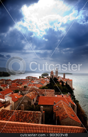Medieval Town Dramatic Sky stock photo, A medieval town with a dramatic storm filled sky by Tyler Olson