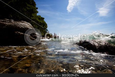 Coast Splash stock photo, A wave splashes against rocks on the croatian coast by Tyler Olson