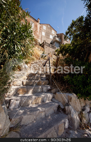 Old Stone Stairs stock photo, Ols stone stairs leading up to a medieval house in Rab, Croatia by Tyler Olson