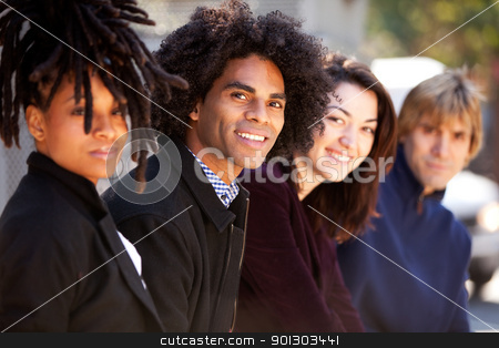 City Friends stock photo, A group of friends in the city - shallow depth of field with focus on African American by Tyler Olson