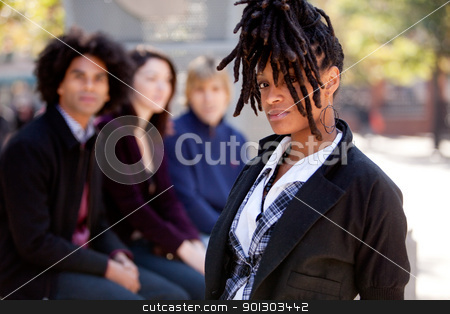 Student with dreadlocks stock photo, A group of young university students outdoors at school by Tyler Olson