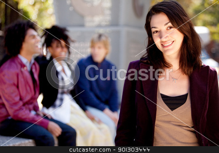 Casual Woman Portrait stock photo, A portrait of a happy young woman with friends by Tyler Olson