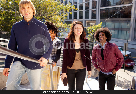 City Friends Casual stock photo, A candid of a group of friends in the city by Tyler Olson