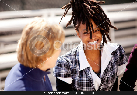 Beautiful Black Woman Smile stock photo, A casual portrait of a beautiful african american with a big smile by Tyler Olson
