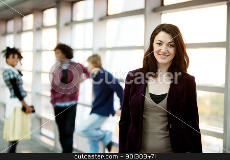 Girl Smile stock photo, A portrait of a young woman with friends in the background by Tyler Olson