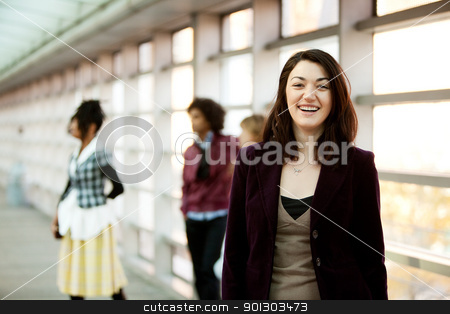 Girl with Friends stock photo, A portrait of a young woman with friends in the background by Tyler Olson