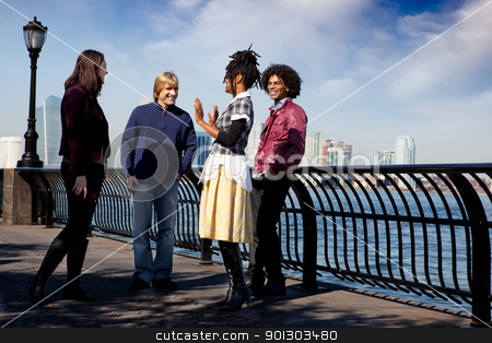 City Friend stock photo, A group of friends on a city walk way by the water by Tyler Olson