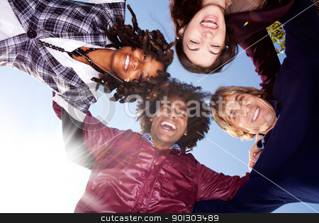 Happy Friend Group stock photo, A happy group hug of friends - with solar flare from bottom left by Tyler Olson