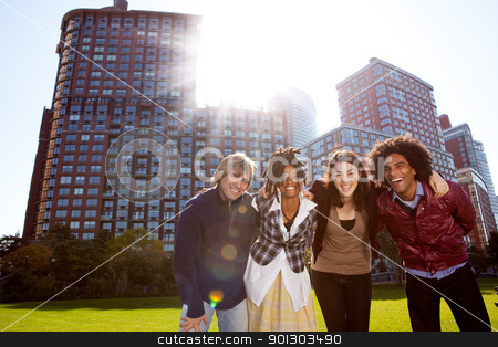 Young Adult City stock photo, A group of young adults in a city park - shot into the sun with solar flare by Tyler Olson
