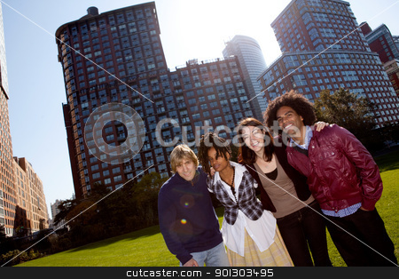 Apartment People stock photo, A group of people in front of an apartment building taken into the sun with solar flare by Tyler Olson
