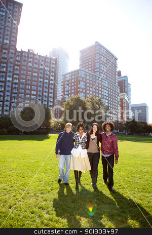College Students stock photo, A group of college students in a park - shot against the sun with solar flare by Tyler Olson