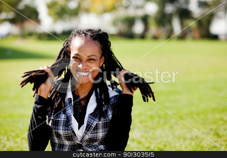 Relax Fun Student stock photo, A young African American woman having fun - isolated on green by Tyler Olson