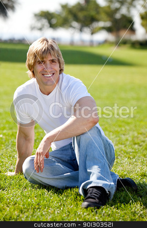 Fit Adult Male stock photo, A fit adult male resting on grass by Tyler Olson