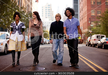 City People stock photo, A group of young people walking down a street in a large city by Tyler Olson