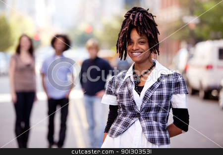 Pretty Woman stock photo, A pretty African American woman in the city with friends by Tyler Olson