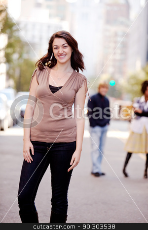 Woman City stock photo, A woman in a city setting with friends in the background by Tyler Olson