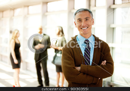 Happy Business Man stock photo, A business man with a big smile by Tyler Olson