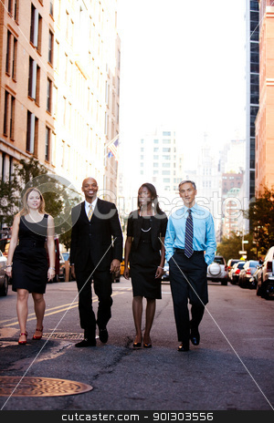 Business Team stock photo, A business team outside on a street in a city by Tyler Olson
