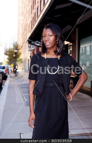 African American Business Woman stock photo, An African American business woman in an urban setting. by Tyler Olson