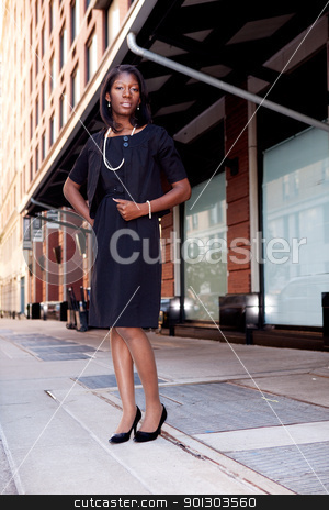 Business Woman on Street stock photo, A business woman in a natural street setting by Tyler Olson